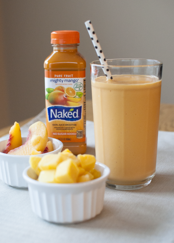 A Delicious Peach Mango Smoothie Recipe featured by top US foodie blogger, Miss Molly Moon