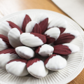 Red Velvet Madeleines dipped in White Chocolate featured by top US food blogger, Miss Molly Moon
