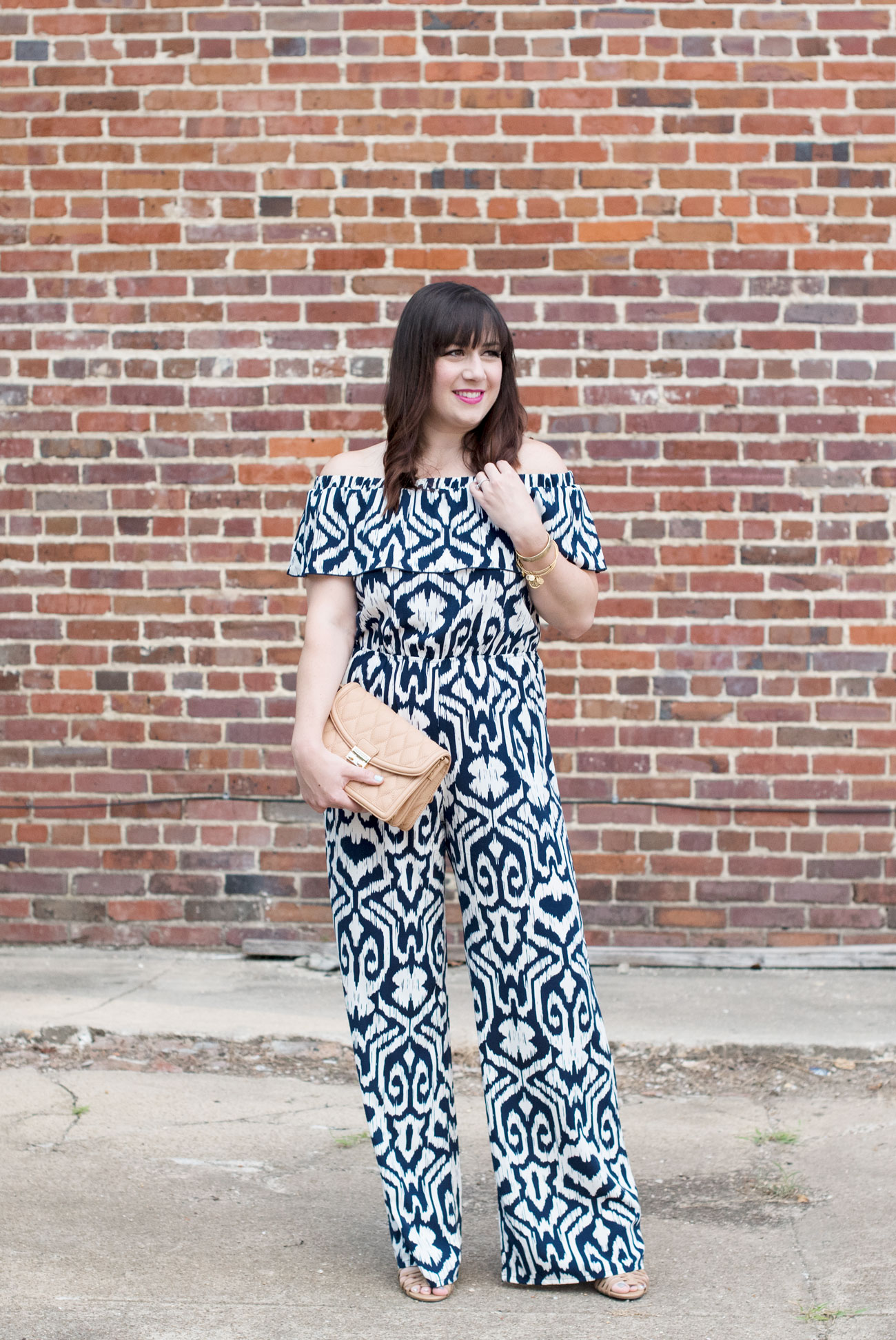 Molly is styling a fun Fab'rik jumpsuit and a Vera Bradley Crossbody | What to wear to a Class Reunion featured by top US fashion blogger, Miss Molly Moon: image of a woman wearing a Fab'ric patterned jumpsuit, a Vera Bradley bag and Target shoes