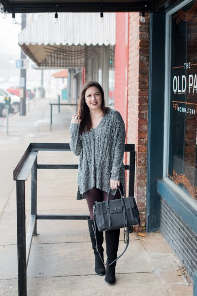 Styling faux leather leggings might sound like a challenge, but it's easy! Top a wine-colored pair of faux leather leggings with a neutral sweater, boots, and bag and you've got an easy every day look.