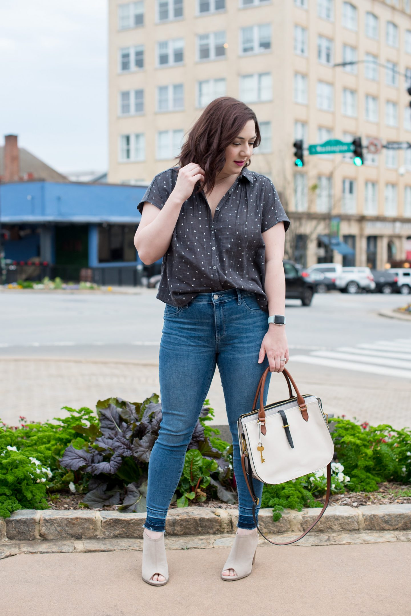 Polka Dot Button Down for Spring // Miss Molly Moon | Casual date night look featured by top Atlanta fashion blogger, Miss Molly Moon: image of a woman wearing a Universal Threads target shirt, GAP skinny jeans, FOSSIL satchel, slide heels