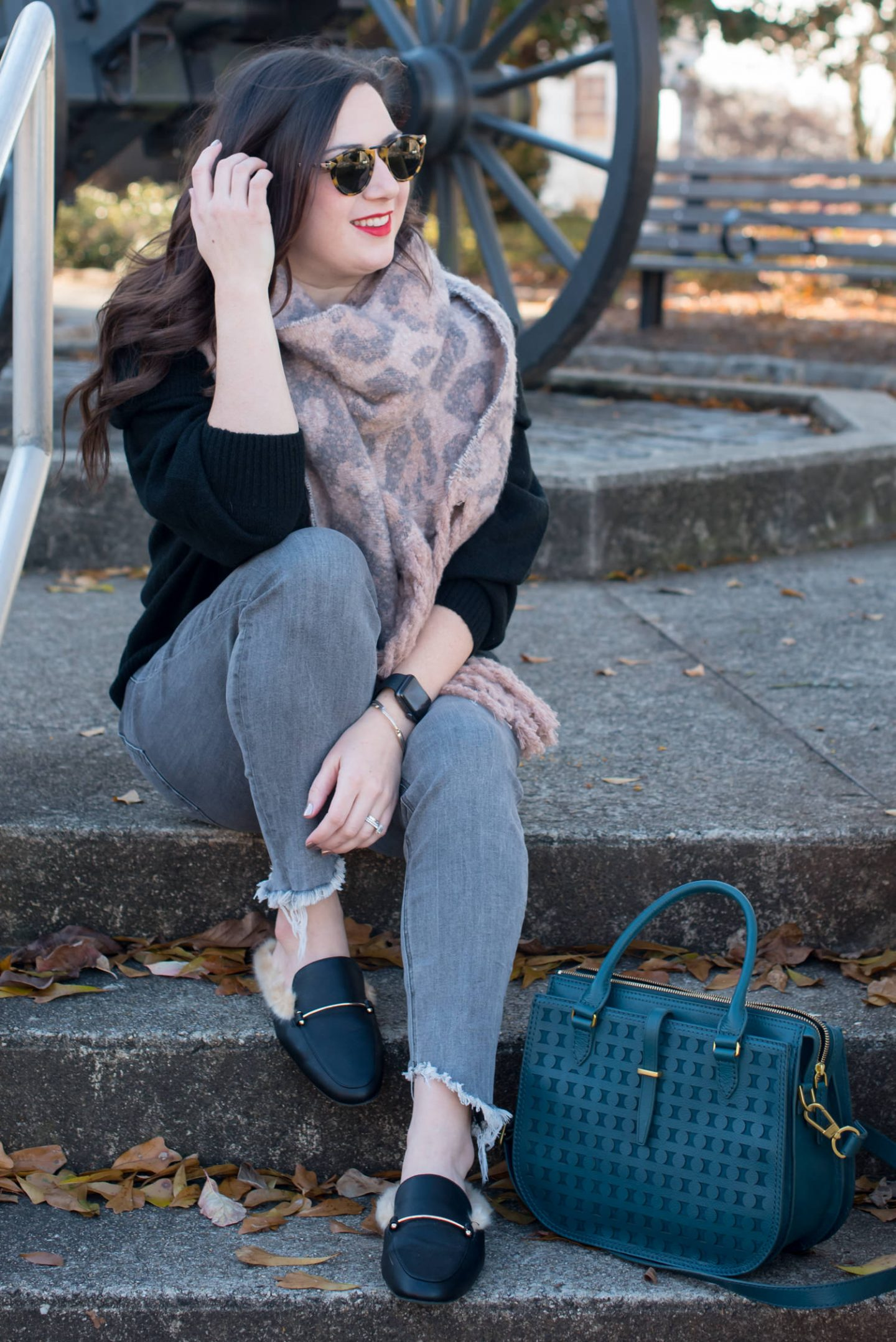 Cozy & Casual Winter Style + Leopard is a Neutral // Miss Molly Moon | Cozy off the shoulder sweater styled by top US fashion blogger, Miss Molly Moon: image of a woman wearing an H&M off the shoulder sweater, Target blanket scarf, Express high waisted ankle denim leggings, Fossil bag and Target faux leather fur mules