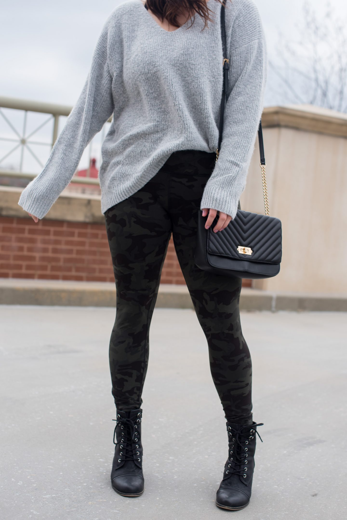Camo leggings featured by top US fashion blogger, Miss Molly Moon: image of a woman wearing Lulu lemon camouflage leggings, Old Nave workout top, On Running shoes, Ray Ban aviator sunglasses